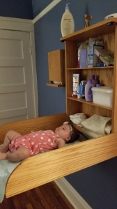 Diaper changing table built into the wall