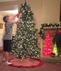 Our youngest son kicking off our Christmas tree decorating last year